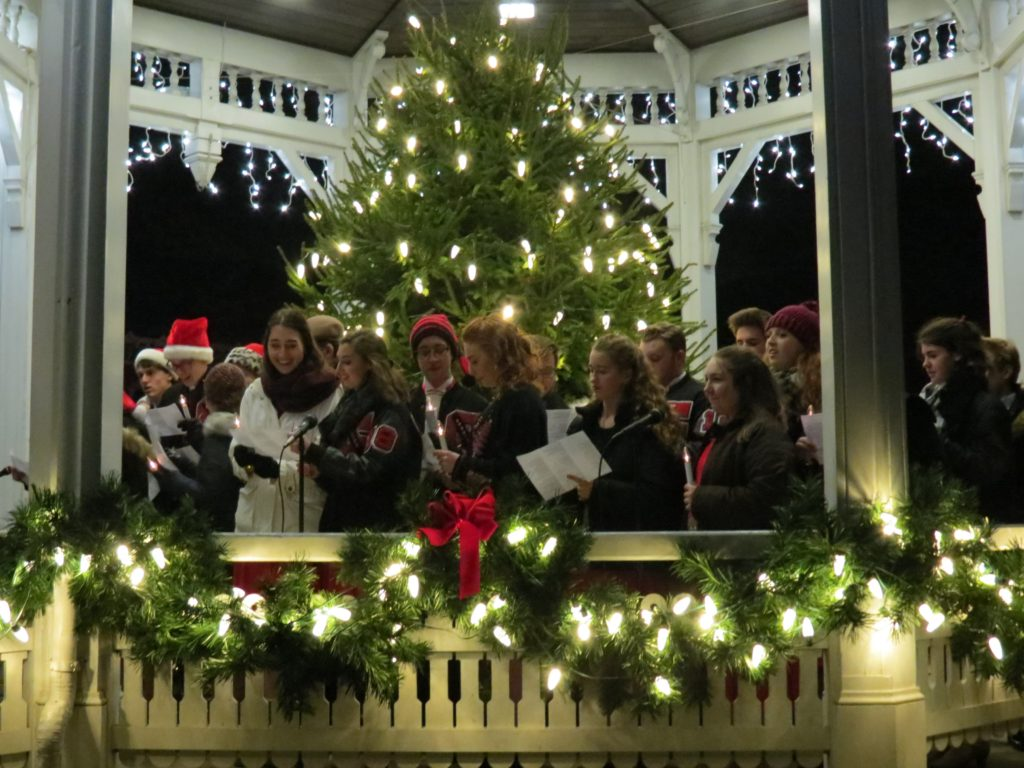 gazebo with christmas tree and lights and free harmony singing