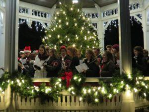 Gazebo with Christmas tree and lights and Free Harmony singing