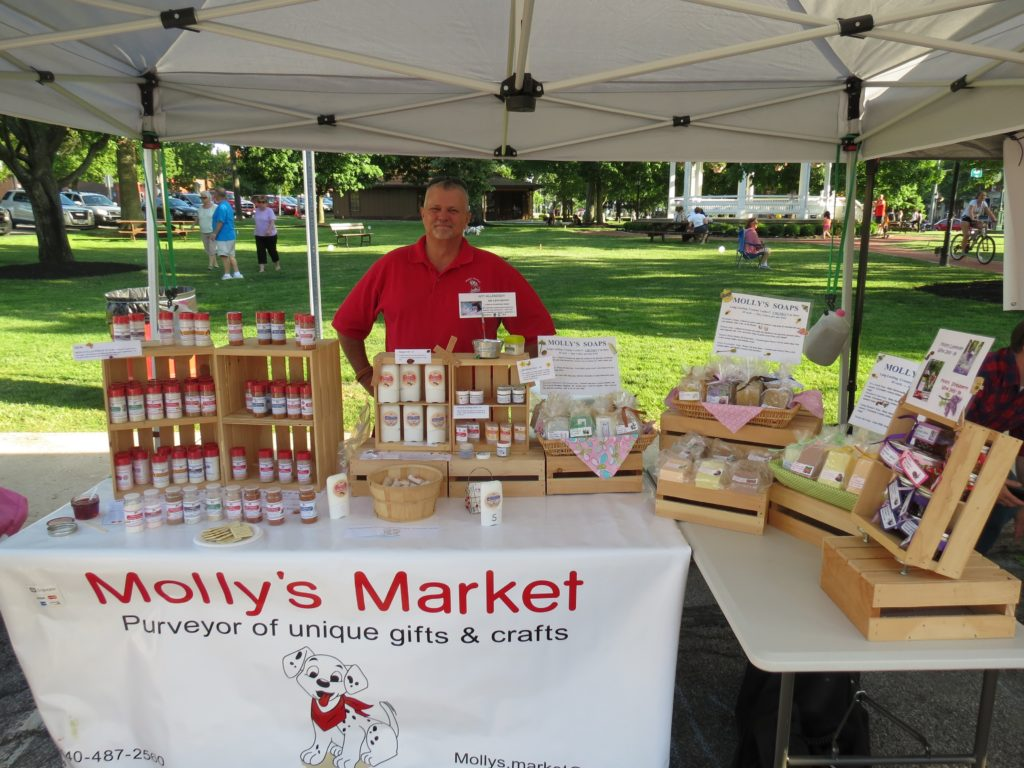 Molly's Market vendor booth at the farmers market