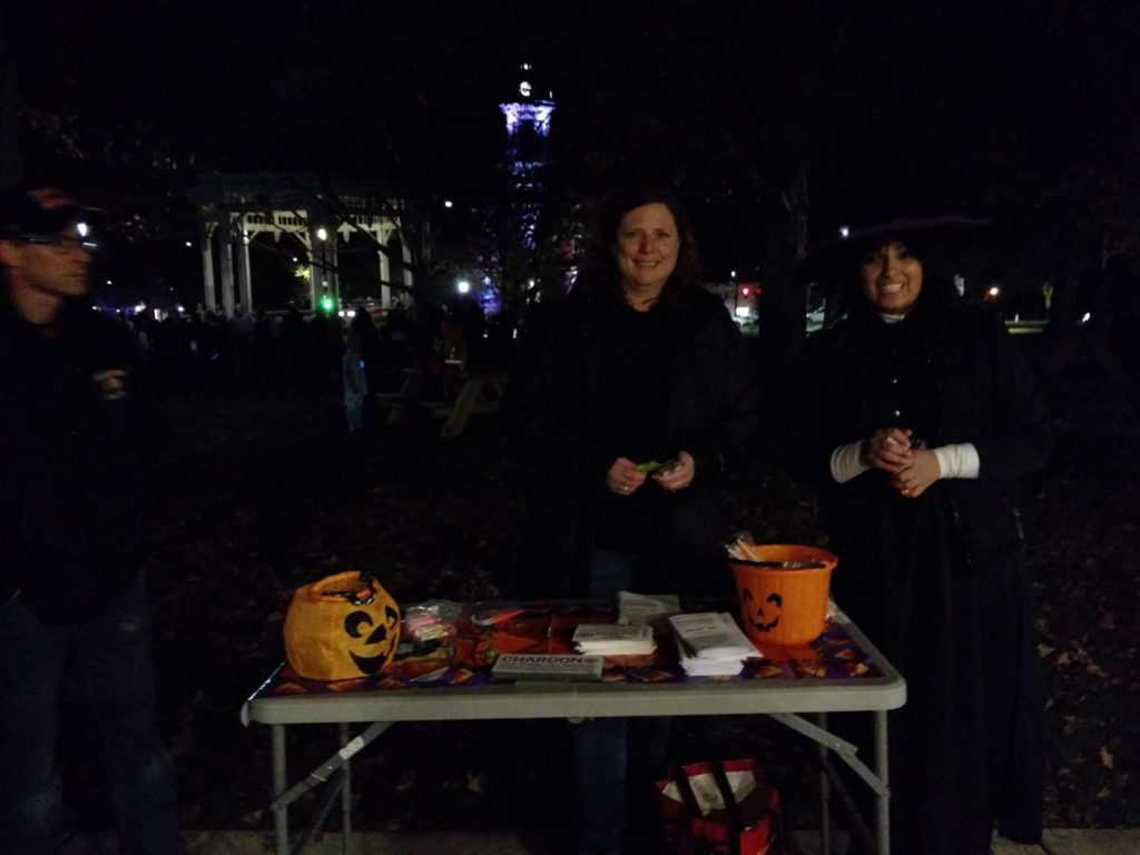 Volunteers handing out candy on the square