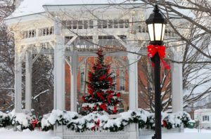 Snow covered gazebo with Christmas tree and lamppost