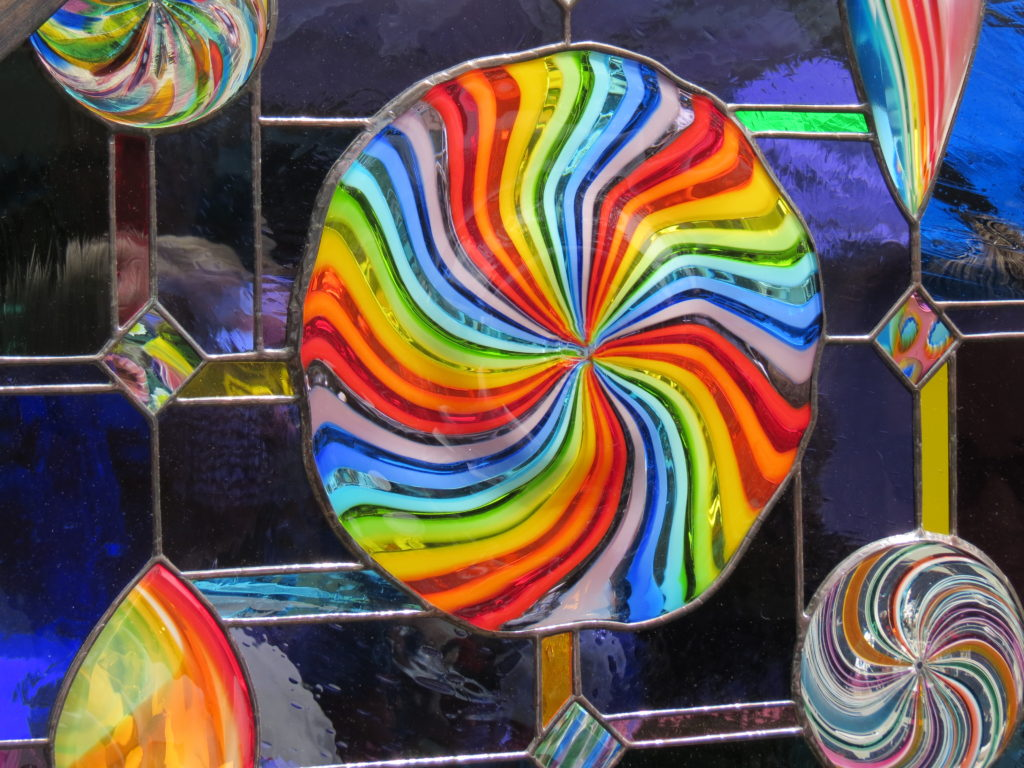 Rainbow spiral stained glass window