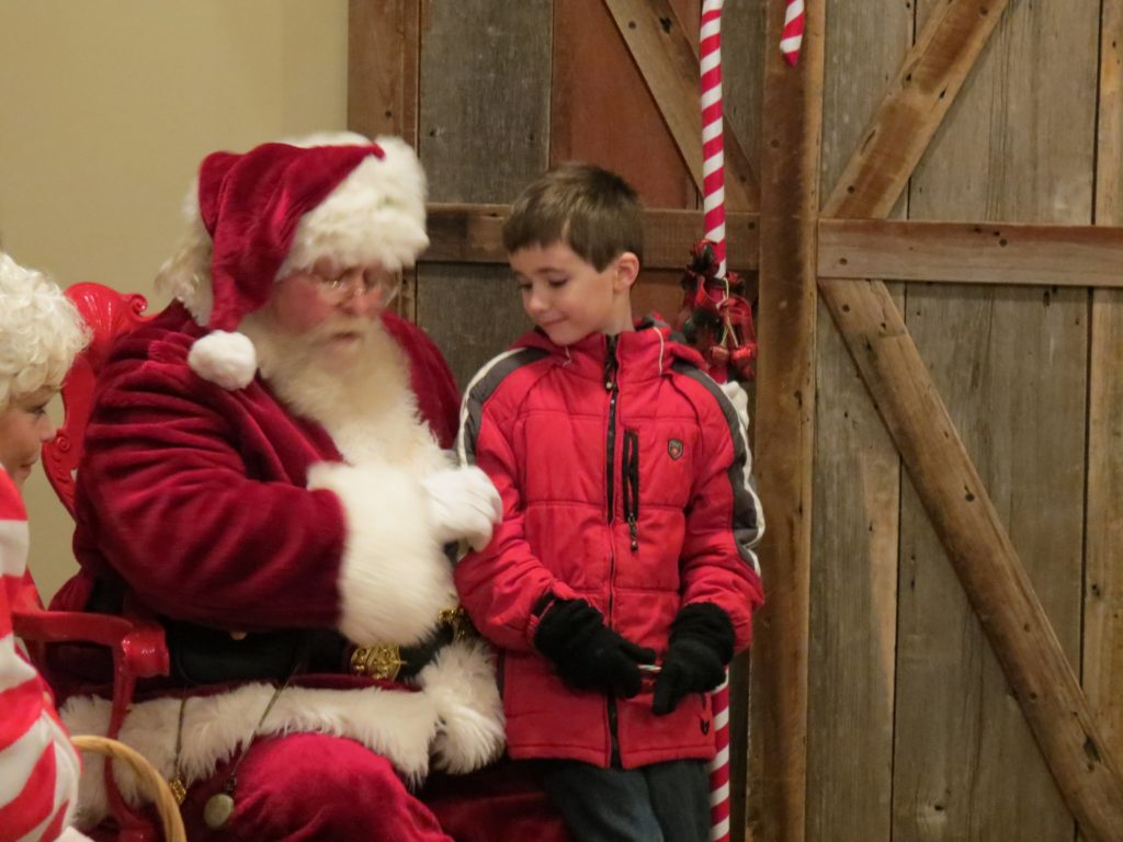 A boy talking to Santa