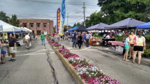Row of vendor booths at the farmers market