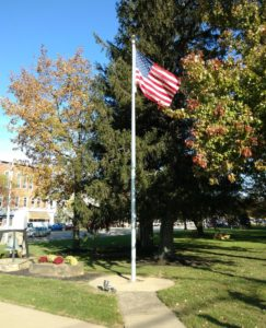 Flagpole with American flag at the south end of the square
