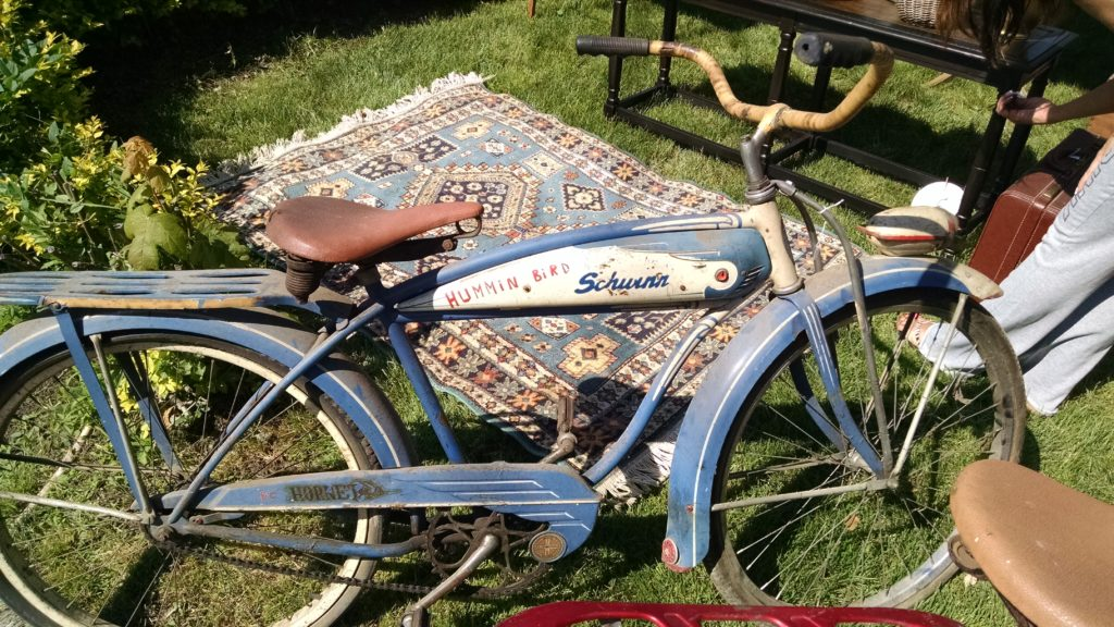Old blue and white Schwinn bike at flea market