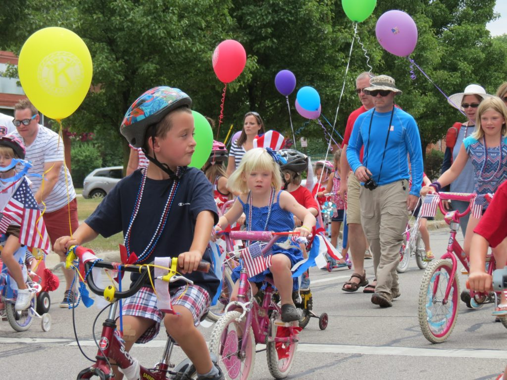 KIds riding their bikes in the parade