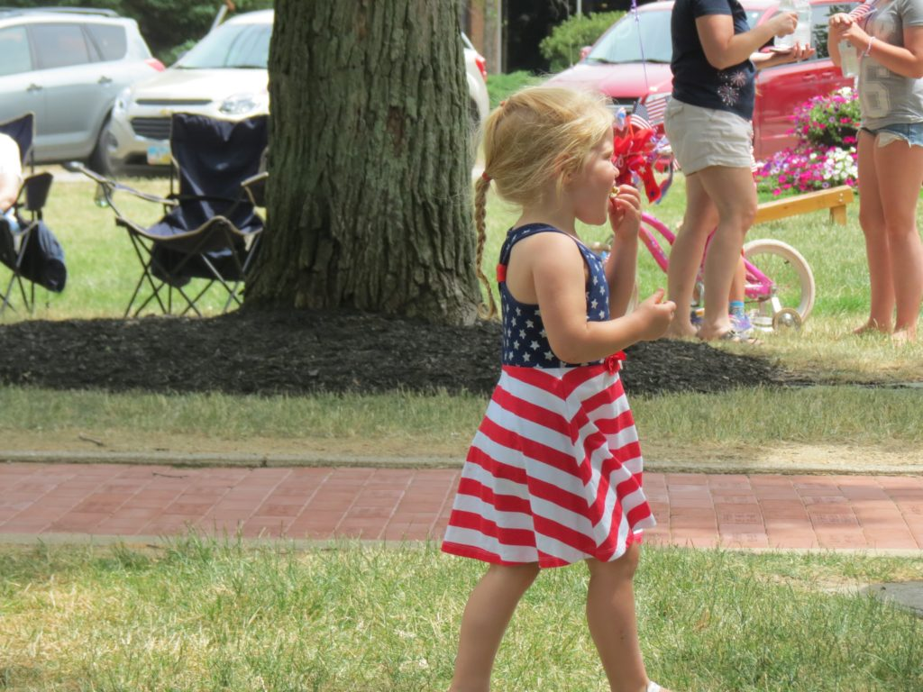 Young girl in a flag print dress
