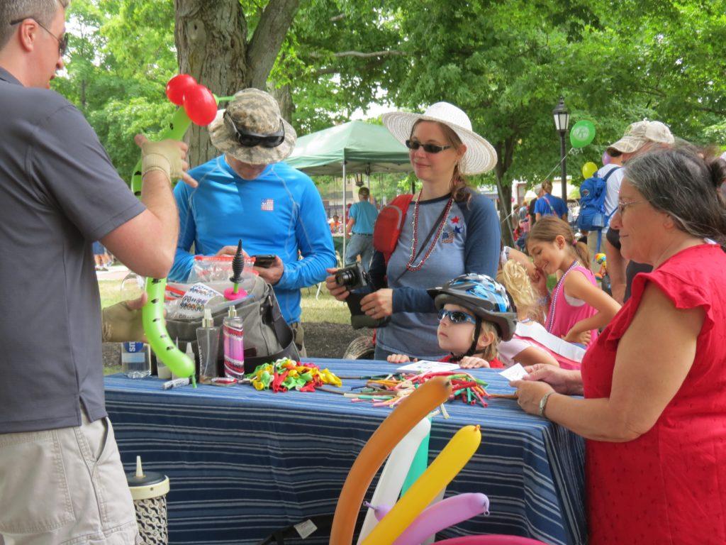 Balloon artist entertaining kids